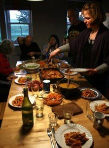 Mairi and retreat participants at dinner table with lots of food
