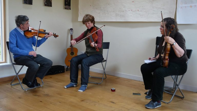 Mairi and two workshops participants playing their fiddles